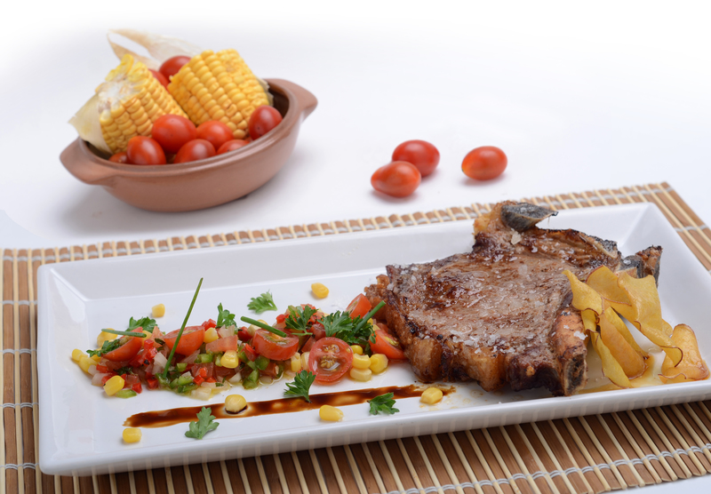TENDER COW RIB WITH NATIVE SAUCE  AND FRESH CORN